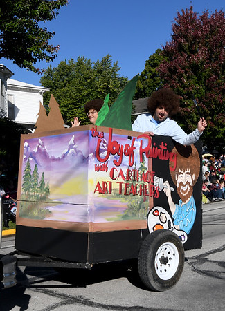 Carthage art teachers join forces to pay homage to celebrity artist Bob Ross during the Maple Leaf Parade on Saturday in Carthage.<br /> Globe | Laurie Sisk