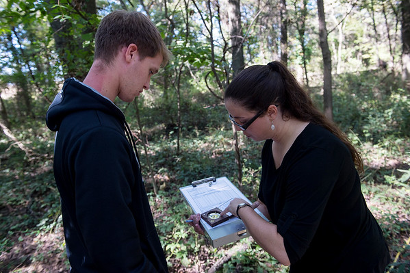 Caleb Durbin, a Pittsburg State University junior from Chanute, and Christine Brodsky, assistant professor of biology at PSU, report information about canopy coverage at a wildlife camera location on Friday near Pittsburg.<br /> Globe   Roger Nomer