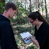 Caleb Durbin, a Pittsburg State University junior from Chanute, and Christine Brodsky, assistant professor of biology at PSU, report information about canopy coverage at a wildlife camera location on Friday near Pittsburg.<br /> Globe | Roger Nomer