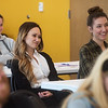 Taylor Moon, assistant professor of graphic design at Missouri Southern, left, and Madalyn Richardson, MSSU senior, listen during Wednesday's Nanette Philibert Business of Art Symposium at Missouri Southern State University.<br /> Globe | Roger Nomer