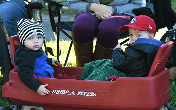 From the left: Tucker Percival, 1 and Henry Richmond, 2, watch the sights and sounds of the Maple Leaf Parade from the comfort of a wagon on Saturday on Grand Avenue in Carthage.<br /> Globe | Laurie Sisk