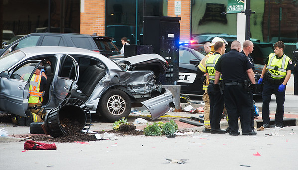 Emergency responders care for the injured following a collision at Sixth and Joplin on Thursday afternoon.<br /> Globe   Roger Nomer