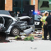 Emergency responders care for the injured following a collision at Sixth and Joplin on Thursday afternoon.<br /> Globe | Roger Nomer