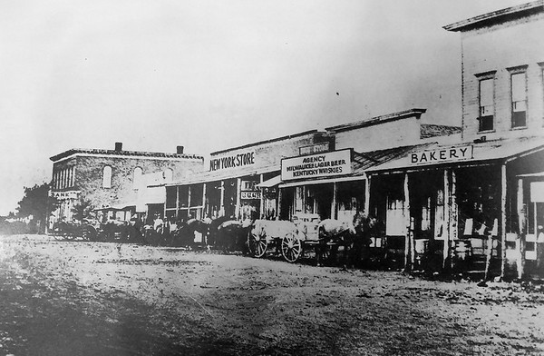 """This photo shows downtown Baxter Springs in 1880, looking south from 10th street. <br /> Photo from """"A Pictorial History of Baxter Springs, Kansas"""" published by Baxter Springs Historical Society"""