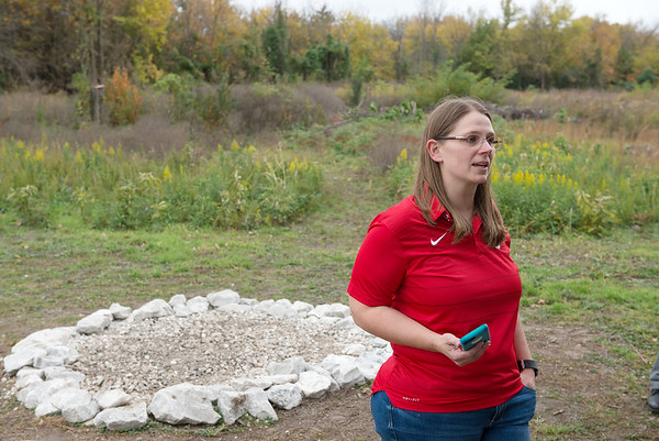 Dione Friel, science teacher at Carl Junction High School, helps dedicate the outside classroom in Carl Junction on Tuesday.<br /> Globe   Roger Nomer