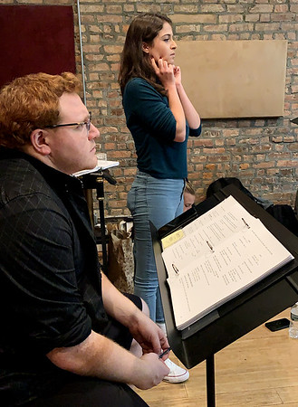 Quentin Madia and Lauren Pelaia, two of the shows creators, watch a run through of the show in rehearsals. (Angelica Gorga)