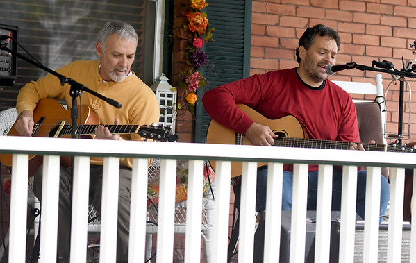 "From the left: Mike Snow and Justin Cauble, of ""Scale House,""  play the blues for visitors of Porch Fest on Saturday in the North Heights Neighborhood.<br /> Globe 