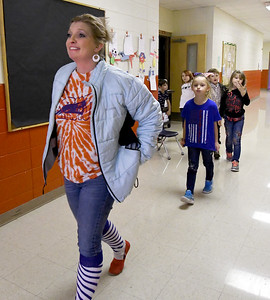 Granby second grade teacher Ashley Wolf leads her class to recess on Friday afternoon at Granby Elementary. The district is reviewing the success of their four-day school week after two years of implementation. Globe | Laurie Sisk