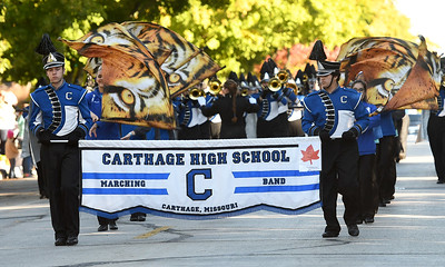Members of the Carthage High School Marching Band entertain visitors during the Maple Leaf Parade on Saturday in Carthage. Globe | Laurie Sisk