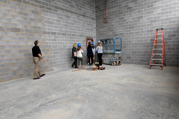 Court and county officials and members of the media tour the exercise area of the new Jasper County Juvenile Justice Center on Wednesday at the center near Sixth and Pearl streets.<br /> Globe | Laurie Sisk