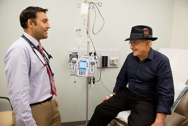 Samir Dalia, oncologist at the Mercy Cancer Center, works with patient Tom Carlin, Neosho, on Oct. 3 at the cancer center.<br /> Globe | Roger Nomer