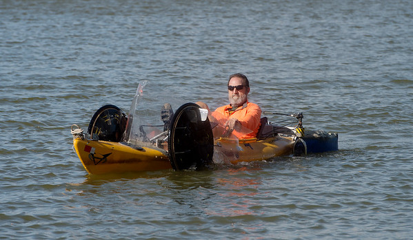 Randy Ridings pedals his quadyak on Kellogg Lake on Monday afternoon.<br /> Globe | Roger Nomer