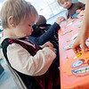 Dressed as a vampire, Kai Larson, 3, Joplin, works on a Halloween craft at the Joplin Public Library on Wednesday.<br /> Globe | Roger Nomer