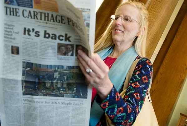 Leesa Robinson, Carthage, reads the first edition of the new Carthage Press before Thursday's press conference at the Carthage Public Library. Robinson is the daughter of Marvin VanGilder, a former columnist and local historian at the Carthage Press.<br /> Globe | Roger Nomer