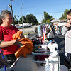 From the left: Gifts for the Nations ministry founder Debbie Cramer assists Kandy Firey with a purchase from the large selection of clothing during a benefit rummage sale on Thursday at Villa Heights Christian Church. Proceeds from the sale will go to benefit the ministry's disaster relief work, which has included disaster cleanup in various parts of the U.S. and Haiti and farming assistance in East Africa and many others. The sale continues through Saturday at the church, located at 2650 E. 7th St.<br /> Globe | Laurie Sisk