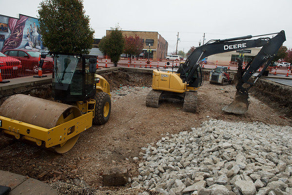 Construction equipment rests in a shallow pit near 8th and Main streets in Joplin on Wednesday.<br /> Globe | Roger Nomer