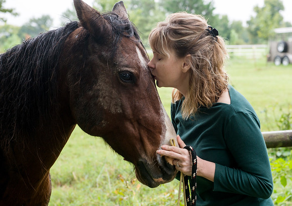 Alice Mangan credits her horse Murphy for helping her through her illness, and hopes to be able to ride again if cannabis therapy from Ammendment 2 is passed.<br /> Globe | Roger Nomer