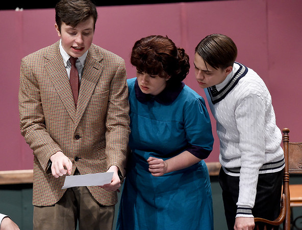 """From the left: Joplin High School students  Jakob Butler, Abby Brower and Matthew Parrott rehearse their roles on Tuesday night for the Upcoming JHS production of """"The Game's Afoot.""""<br /> Globe 