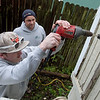 Andrew Wilson, left, and Chris Burrow, with Sycamore Homes, check for insulation at a house in Joplin on Wednesday.<br /> Globe | Roger Nomer