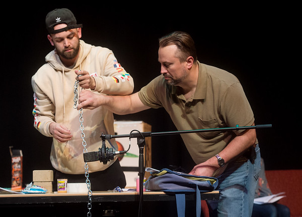 Jason Knowles, assistant professor of media production at Pittsburg State University, helps Braiden Turner, senior, use a chain for a Foley effect on Tuesday at the Bicknell Family Center for the Arts.<br /> Globe | Roger Nomer