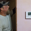 Anthony Barnes, with Blaylock HVAC, helps install a new heating unit and progammable thermostat at a house in Joplin on Wednesday.<br /> Globe | Roger Nomer