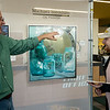 Michael Steddum talks about his paintings with Gage Williams, Missouri Southern senior, during Wednesday's Nanette Philibert Business of Art Symposium at Missouri Southern State University.<br /> Globe | Roger Nomer
