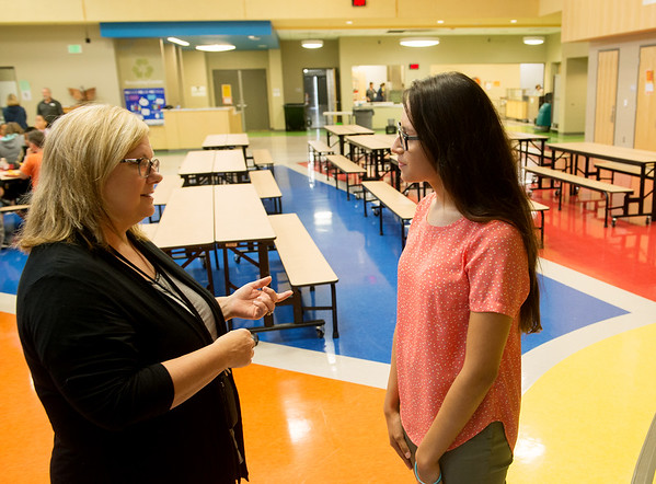 Deanna Hunter, social worker at Beacon School, left, talks with Jazmine Rodriguez, a Missouri Southern senior from Purdy, at Soaring Heights Elementary on Monday.<br /> Globe | Roger Nomer