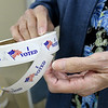 "Election official Sue Becker holds a roll of ""I Voted"" stickers during early voting for the 2018 midterm election at the Homer Cole Community Center on Tuesday in Pittsburg. Election officials reported heavy turnout for early voting at the site.<br /> Gobe 