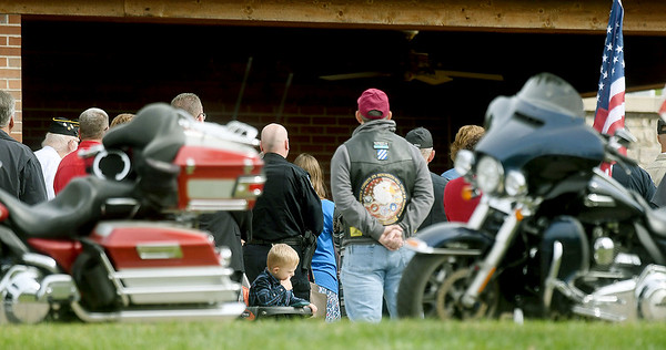Flanked by members of the Patriot Guard, loved ones gather for the burial of WWII soldier Leslie Shankles, of Arcadia at the Fort Scott National Cemetery on Wednesday. Shankles body was returned home 74 years after his death.<br /> Globe | Laurie SIsk