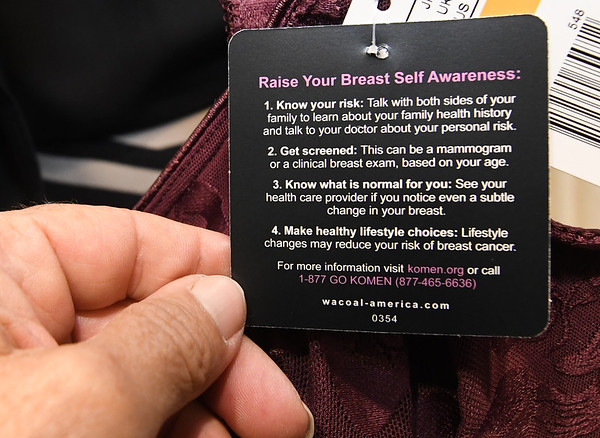 A tag on a bra at Sister's Boutique gives tips on how to increase your breast cancer awareness.<br /> Globe | Laurie Sisk