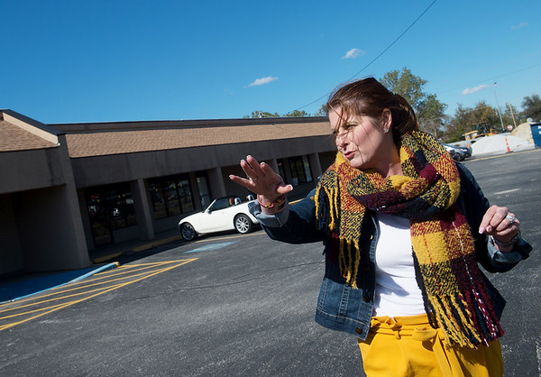 Christine Pennington, property manager of Creekside Plaza, talks about planned changes to the property on Tuesday.<br /> Globe | Roger Nomer