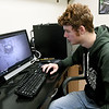 Pittsburg State University biology major Ryan McGinty looks over video he captured of a gray bat roost in Pittsburg. PSU researchers are monitoring incidents of white nose syndrome, which can be fatal to bat colonies.<br /> Globe | Laurie Sisk