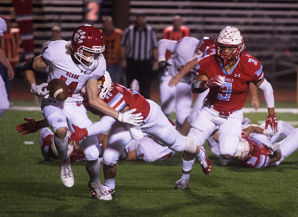 Webb City's Sergio Perez (3) rushes to assist on teammate Treghan Parker's (11) tackle of Ozark's Tucker Moeller during Friday's game in Webb City.<br /> Globe | Roger Nomer