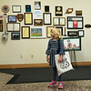 After receiving a Joplin tote bag, Taylor Duncan, 5, tours Joplin City Hall on Thursday.<br /> Globe | Roger Nomer