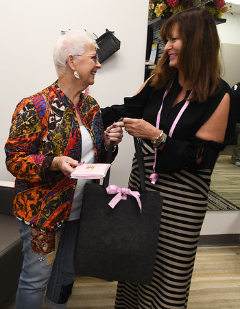 From the left: Cancer survivor Stella McGowen receives a free tote bag from Wacoal consultant Nancy Balkenbush inside Sisters Boutique at Joplin Mercy Hospital.<br /> Globe | Laurie Sisk