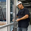 Nathan Mitchell, of Commercial Glass and Metal, installs a handle on a door to the courtyard  of the new Jasper County Juvenile Justice Center as court and county officilas and members of the media tour the building on Wednesday near Sixth and Pearl streets.<br /> Globe | Laurie Sisk