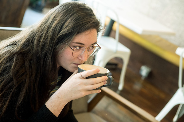 Brennan Crossgrove, student at College of the Ozarks, visits with a friend at Bearded Lady Roasters on Friday.<br /> Globe | Roger Nomer