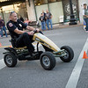 Joplin Police Chief Matt Stewart rides in a race during Third Thursday in downtown Joplin. The fire and police chiefs were on hand to promote the passage of Prop B.<br /> Globe | Roger Nomer