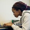 Tiffany Ndauwa, eighth grader at East Middle School, works on a comm arts assignment on Thursday.<br /> Globe | Roger Nomer