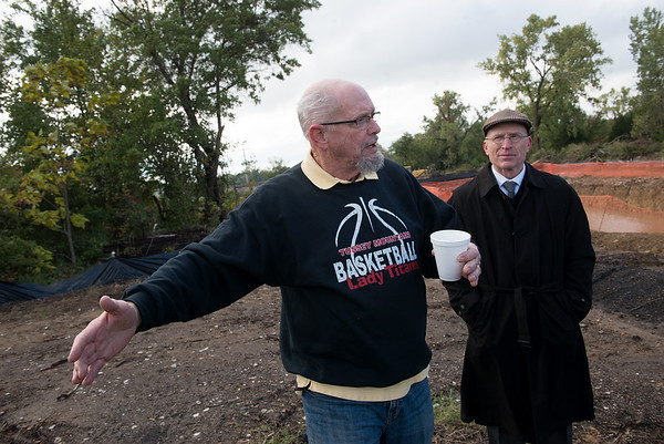 Bob Boys, property owner, and Jay Byers, deputy city manager of Pittsburg, talk about redevelopment of mined land in Pittsburg on Monday.<br /> Globe | Roger Nomer