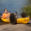 Randy Ridings pedals his quadyak out of Kellogg Lake on Monday afternoon.<br /> Globe | Roger Nomer