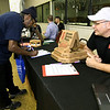 Mike Johnson, right, owner of Simple Simon's Pizza, chats with Edward Henderson, left, as he fills out an application during a veteran's hiring event sponsored by the DAV on Tuesday at the VFW Post 534 of Joplin. Johnson is a veteran of both the U.S. Navy and the U.S. Army and Henderson is a U.S. Army veteran.<br /> Globe | Laurie SIsk