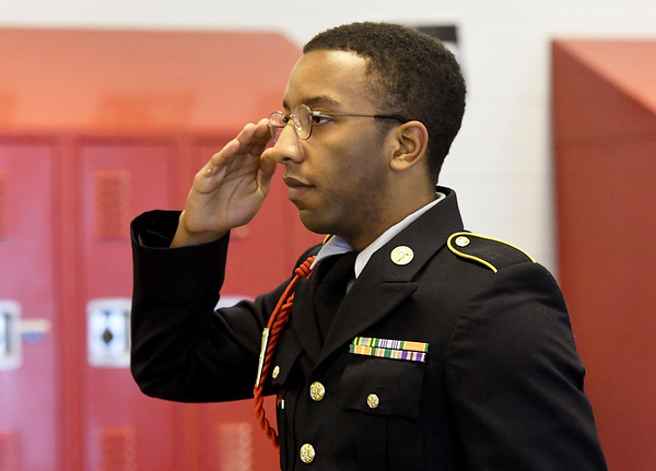 Joplin High School JROTC Cadet Ja Kai Bryant salutes a promotion board of fellow cadets David Ward, John Pogue and Gavin Malone after he answers questions on Thursday at JHS. The JHS JROTC will be celebrating its 100th Anniversary this spring.<br /> Globe | Laurie Sisk