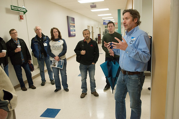Charles Brown, IT instructor at Crowder College talks to visitors at the Advanced Training and Technology Center on Friday during the annual economic development tour.<br /> Globe | Roger Nomer