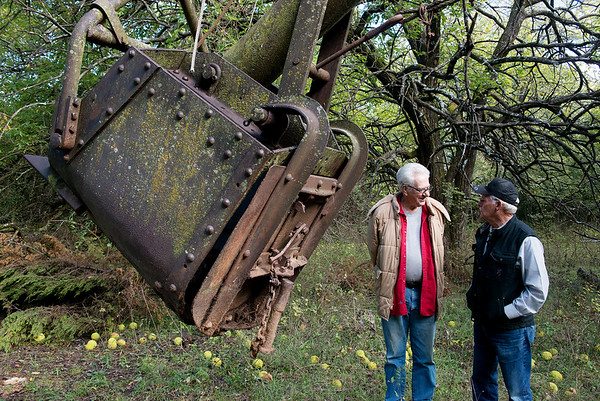 Jerry Henson, left, and Jim Lovell talk near the scoop of the Markley Shovel on Tuesday in Cherokee, Kan.<br /> Globe | Roger Nomer
