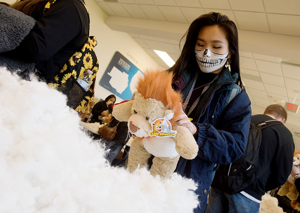 Mary Pham, a Missouri Southern freshman from Joplin, fills her lion during the Stuff A Lion event at Missouri Southern on Thursday.<br /> MSSU students stuffed their bear and then dressed it as a Spiderlion for a Halloween event.<br /> Globe | Roger Nomer