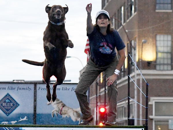 "Handler Molly Johnson launches a toy into the water for ""Air Maddie"" during the Dock Dogs demonstration on Third Thursday in Downtown Joplin.<br /> Globe 