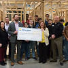 Will Endicott, territory manager of business and community development for Liberty Utilities, left with check, presents a check for $2,000 to Valerie Searcy, executive officer of the Home Builders Association of Southwest Missouri, right with check, for the Foundation of the Home Builders Association of Southwest Missouri on Monday at Franklin Tech. The money will help the foundation in sustaining a long-term plan to place students into job programs and awarding scholarships to graduating high school seniors going into the residential construction industry.<br /> Globe | Roger Nomer