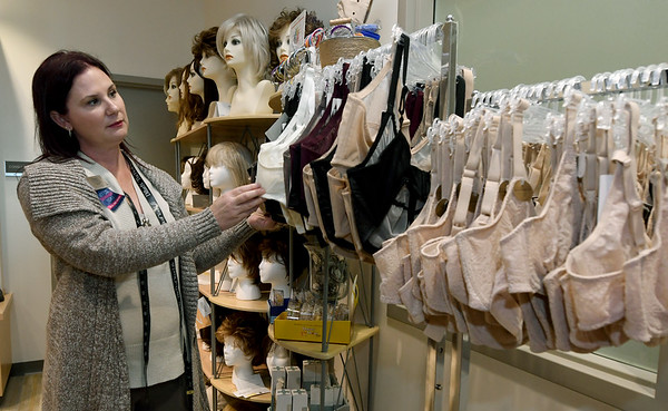 Alicia Hennigh, Springfield Dillard's business manager, looks through the selection of bras at Joplin Mercy's Sisters Boutique.<br /> Globe | Laurie Sisk