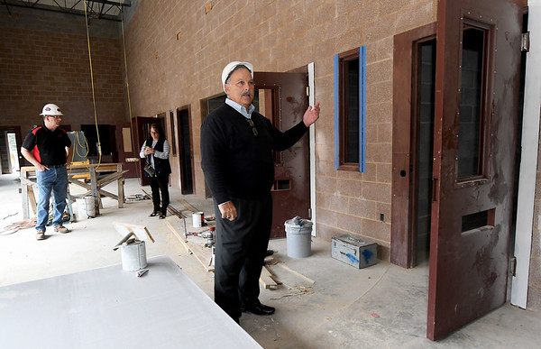 Architect Dan Rowe leads a tour inside the detention area of the new Jasper County Juvenile Justice Center with court and county officilas and members of the media on Wednesday at the center near Sixth and Pearl streets.<br /> Globe | Laurie Sisk